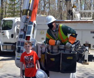 Max McCool poses with Central Maine Power Co. lineman Greg Haven at Max's home in Newcastle on Thursday, May 14. CMP presented McCool with thank-you gifts. (Paula Roberts photo)