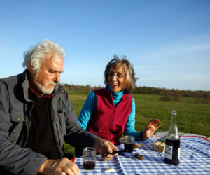 Herb Hartman and Lucy Martin enjoy the Charcuterie-To-Go Picnic Pack at one of Sheepscot General's picnic tables. (Photo courtesy of Kristin Dillon - Blue Horse Photography)
