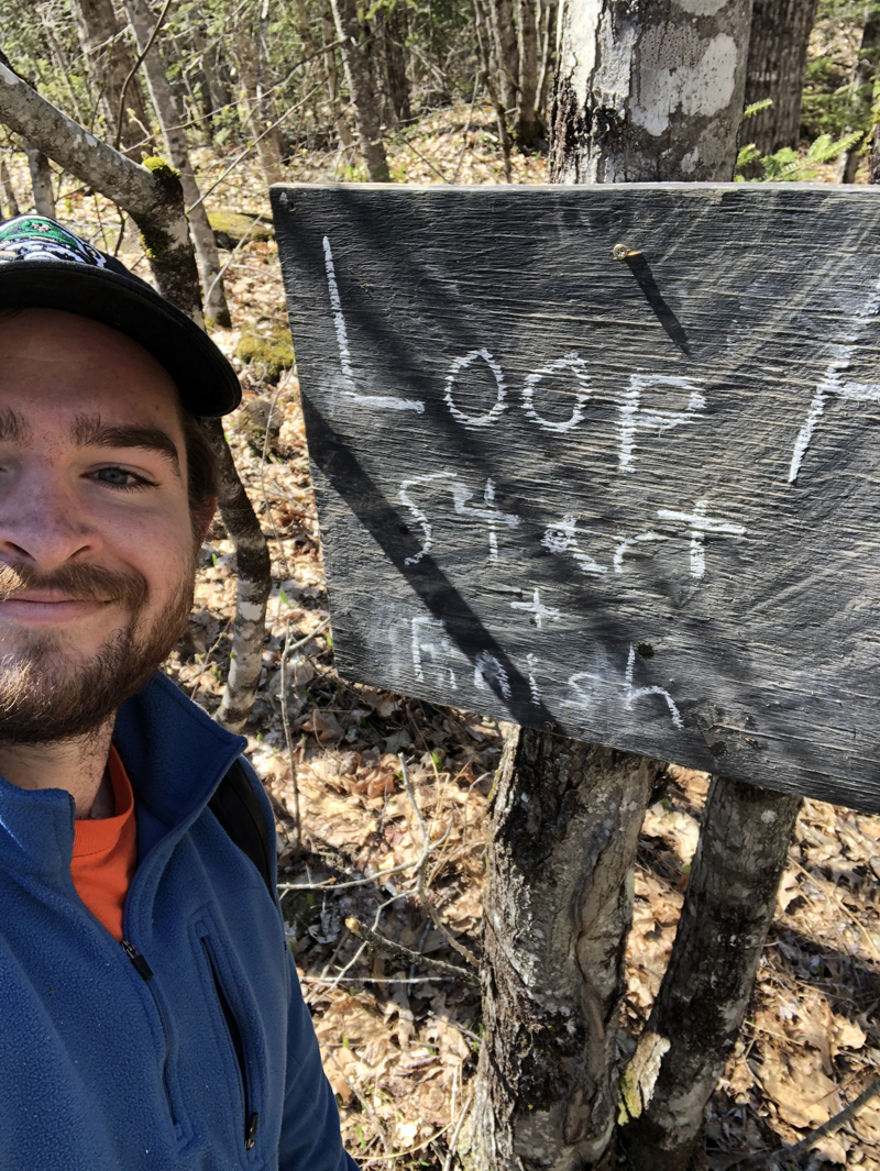 A Midcoast Conservancy AmeriCorps volunteer makes sure the trails are clearly marked for runners.