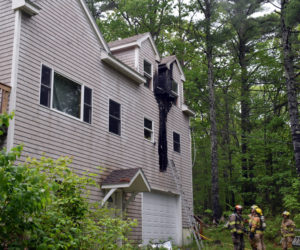 Firefighters assess the damage to a home at 99 Atwood Lane in Bristol after extinguishing a fire caused by a lightning strike the afternoon of Saturday, June 6. (Evan Houk photo)