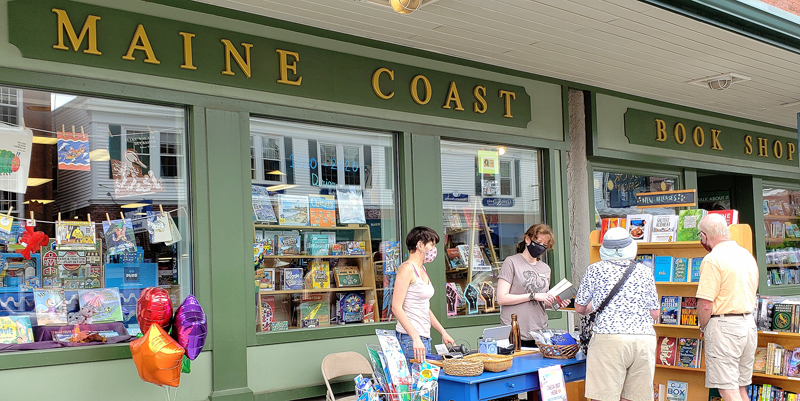 Sherman's Maine Coast Book Shop employees help customers during the first open-air market in downtown Damariscotta, Saturday, June 13. (Photo courtesy Jeff Friedman)