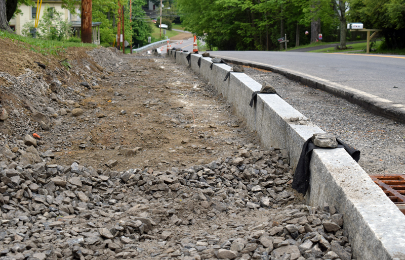 Granite curbing for a new sidewalk lines Bristol Road in Damariscotta on Wednesday, June 3. The contractor had to remove a layer of base gravel after the material failed several tests. (Evan Houk photo)
