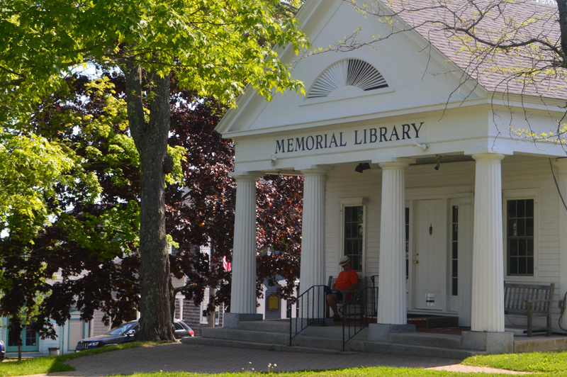 A visitor makes use of the Wi-Fi outside Boothbay Harbor Memorial Library. Across Maine, libraries have continued to provide free internet access to the public. (Alyce McFadden photo)
