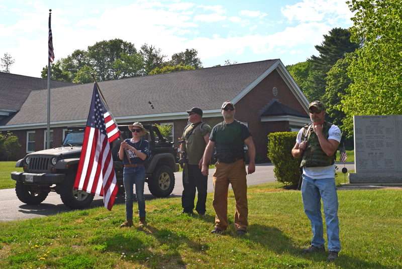 Counterprotesters stand silently across Route 1 from a demonstration at the Lincoln County Sheriff's Office in Wiscasset on Friday, June 5. (Hailey Bryant photo)