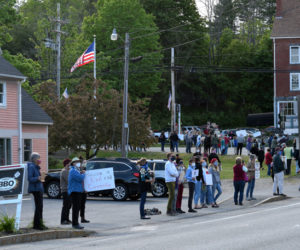 Protesters line the sidewalk around Veterans Memorial Park in Newcastle on Monday, June 1. The silent demonstration was in support of Black Lives Matter protests around the country. (Hailey Bryant photo)