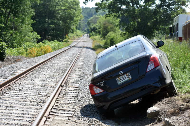 A Nissan Versa along the railroad tracks in Nobleboro after a crash, Tuesday, June 23. (Alexander Violo photo)