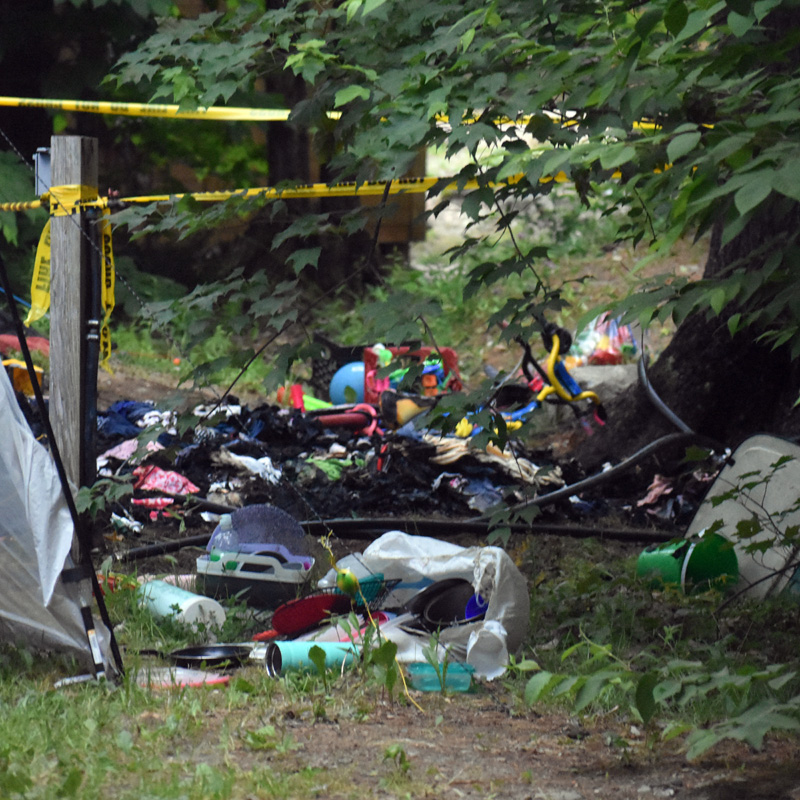 Caution tape warns bystanders away from the scene of a tent fire at Duck Puddle Campground on Wednesday, June 24. The tent and its contents were destroyed. (Alexander Violo photo)
