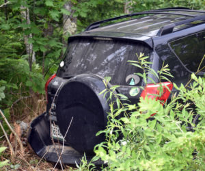 A Toyota RAV4 in the woods off of Route 1 in Waldoboro after a collision, Tuesday, June 23. (Alexander Violo photo)