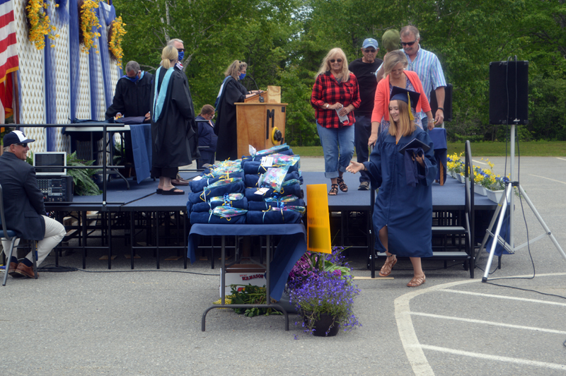 Lillian McCormick steps down from the graduation stage, followed by four family members, after receiving her diploma. (Alyce McFadden photo)