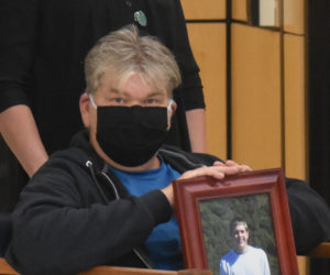 Millard Jackson holds a photo of his late son, Gregori Jackson, during a press conference at the Burton M. Cross Building in Augusta on Thursday, June 11. The Jackson family supports District Attorney Natasha Irving's pledge to prosecute a former reserve police officer for the fatal shooting of Gregori Jackson in 2007. (Alexander Violo photo)