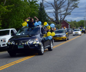 A soon-to-be graduate of Medomak Valley High School cheers from the moonroof of a vehicle during a motorcade Sunday, June 7. (Alyce McFadden photo)