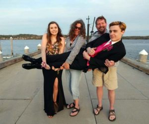 Connor McLean poses for a photo with his family on the occasion of his senior prom in 2019. From left: sister Maddie McLean, mom Elizabeth MacKenney, and stepfather Scott MacKenney. (Photo courtesy Elizabeth MacKenney)