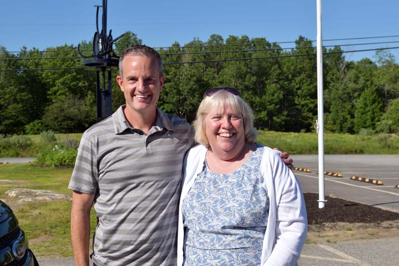 Josh Chase congratulates longtime Whitefield Elementary School teacher Gail Beck on her retirement during a celebration outside the school Friday, June 19. Chase was a student in Beck's first class at Whitefield Elementary, 38 years ago, and drove from Portland to wish her well. (Hailey Bryant photo)