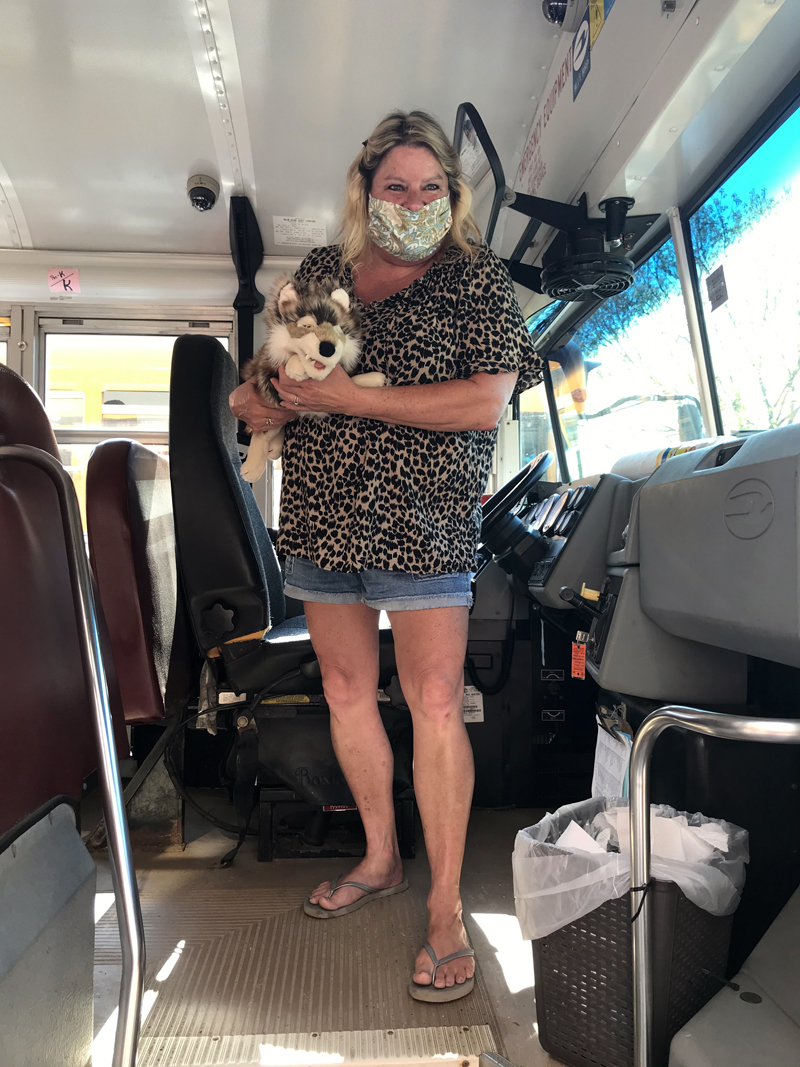 Wiscasset School Department bus driver Cathy Sherman holds Wolfie as she prepares to drive the puppet to a secret destination for the weekend. Young students use clues to find Wolfie each weekend. (Photo courtesy Carole Drury)