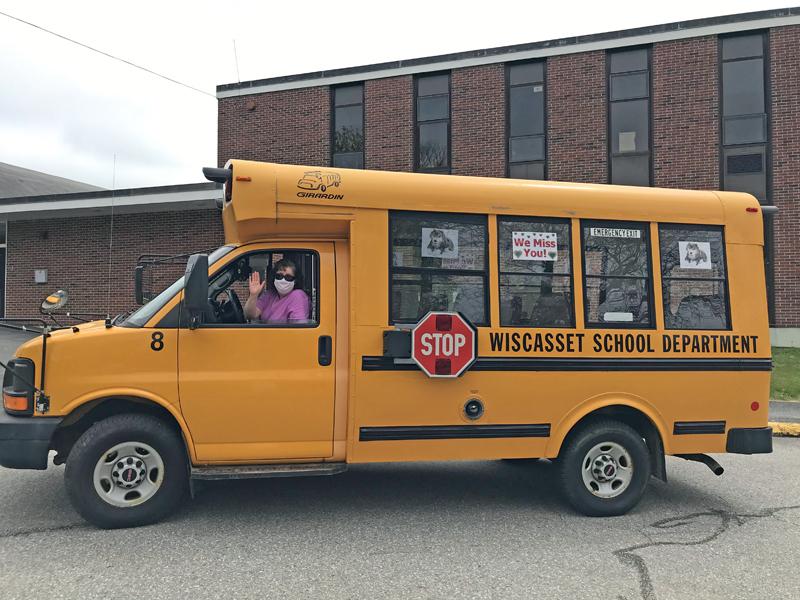 Wiscasset Elementary School music teacher Carole Drury waves from Wolfie's bus at the school. (Photo courtesy Carole Drury)