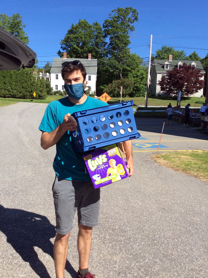Volunteer David Munger helps to unload diapers for the Ecumenical Diaper Bank.