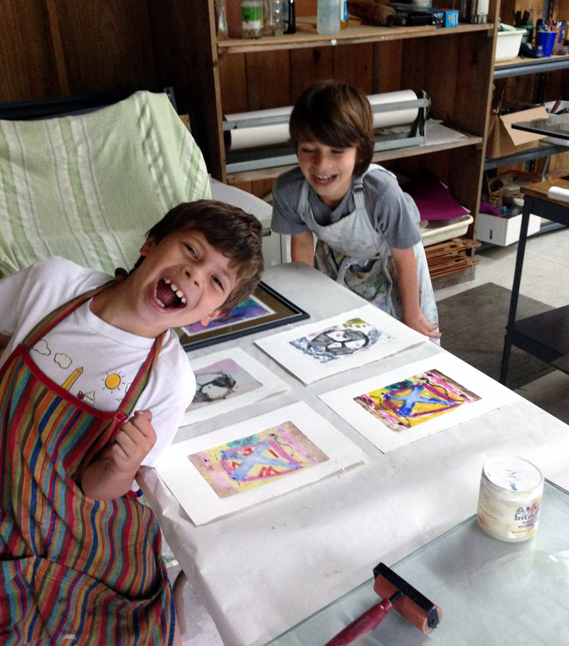 Two students of Midcoast Printmakers enjoy their time in the studio.