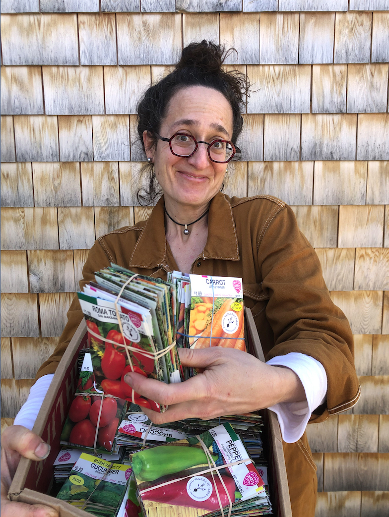 Erica of Veggies to Table readies a basket of seedlings to be delivered to local families.