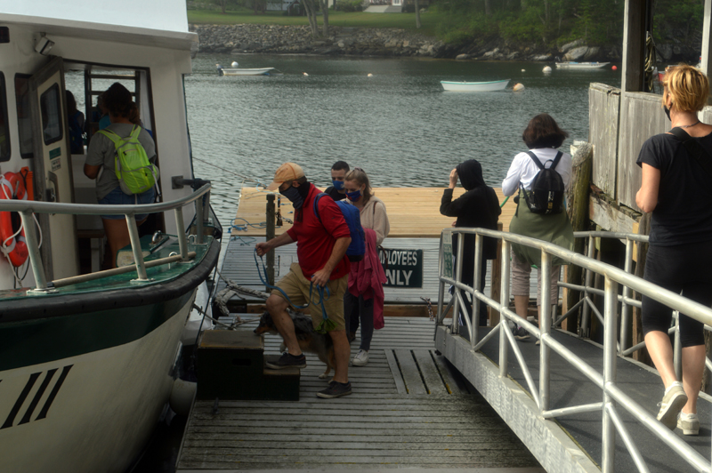 Human and canine passengers board the Hardy III for ferry service to Monhegan Island at the dock in New Harbor on Thursday, July 2. Hardy Boat Cruises has a cap on 43% of capacity to allow for physical distancing. (Alyce McFadden photo)