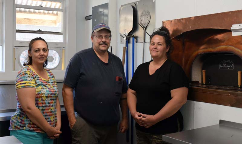 The business partners behind The Village Grill Co. in Damariscotta stand in front of the roadside eatery's new $25,000 Le Panyol wood-fired oven, Monday, July 6. From left: Missy Crockett, Paul Blomquist, and Tricia Spinney. (Evan Houk photo)