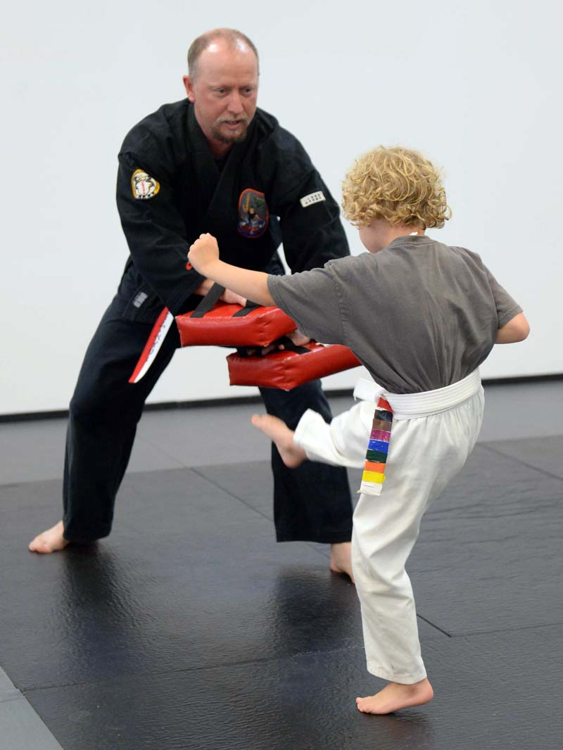 Clement Bailey, owner of Maine Isshinryu Karate Academy Great Salt Bay, blocks a kick from a young student. The Damariscotta studio has closed permanently, citing impacts from COVID-19. (LCN file photo)