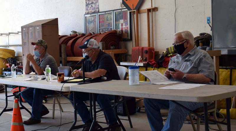 The Dresden Board of Selectmen presides over annual town meeting in the fire station the morning of Saturday, July 18. From left: Third Selectman Allan Moeller, Second Selectman Gerald Lilly, and First Selectman John Rzasa. (Evan Houk photo)