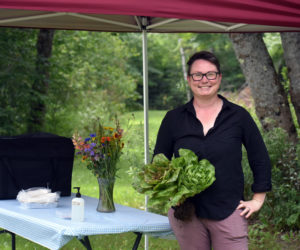 Morgan Bleimeyer, owner and chef at Red Stove Farm & Provisions, by the takeout station at her new business in Jefferson. (Alexander Violo photo)