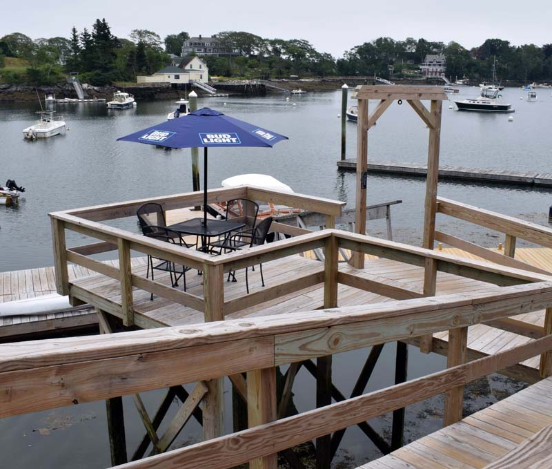 The bistro deck at Coveside Restaurant and Marina in South Bristol offers customers a secluded eating area overlookiing Christmas Cove. Coveside is open Thursday-Saturday from 11:30 a.m. to 9 p.m. (Evan Houk photo)