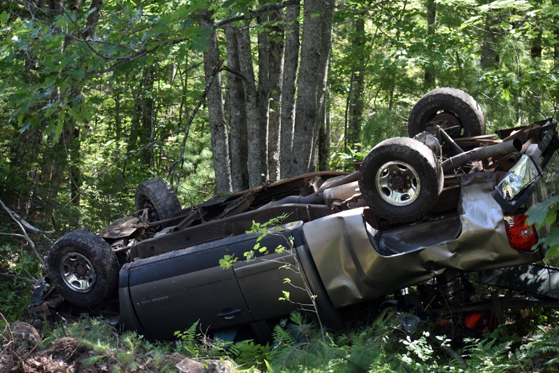 A Chevrolet pickup rests upside down off Route 17 in Somerville on Monday, July 20. The driver was taken to MaineGeneral Medical Center in Augusta, according to a sheriff's deputy. (Alexander Violo photo)