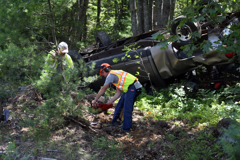 A tree is cut to clear the way for the removal of a pickup after a rollover on Route 17 in Somerville, Monday, July 20. (Alexander Violo photo)