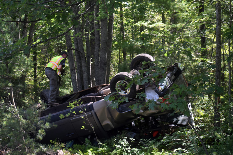 An overturned pickup is secured prior to its removal from an area off Route 17 in Somerville, Monday, July 20. (Alexander Violo photo)