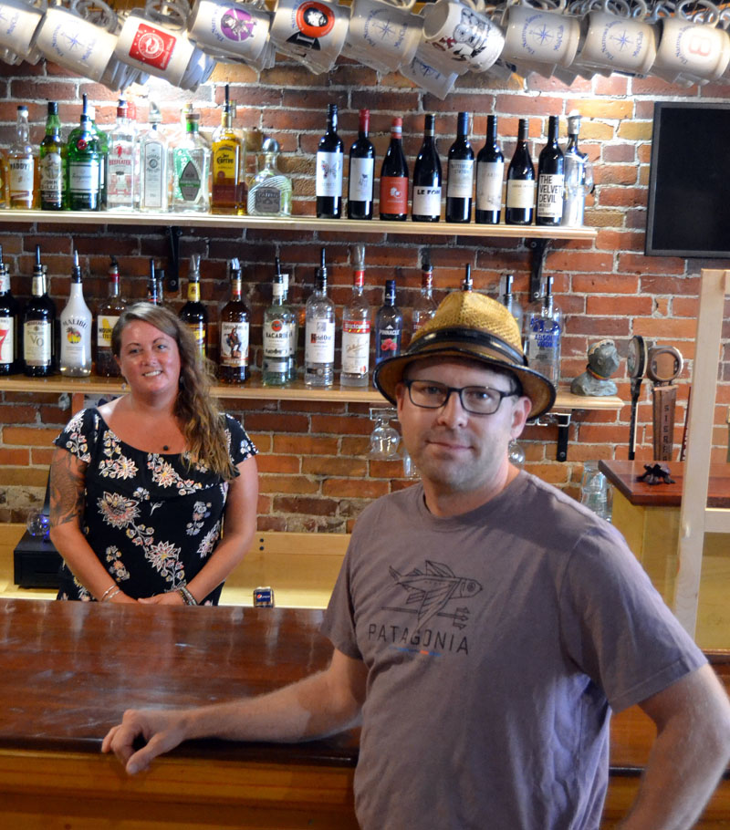 The Narrows Tavern manager Kristen Weeks and owner Jeff Hurd stand near the newly refinished bar in the restaurant. After closing in March due to the COVID-19 emergency, The Narrows will reopen Wednesday, Aug. 5, with a fundraiser for The Waldo Theatre. (Maia Zewert photo)