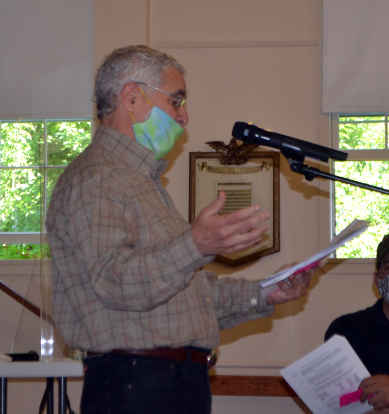 North End Road resident Ralph Jacobs addresses the Westport Island town meeting in the historic town hall, Thursday, July 18. (Charlotte Boynton photo)