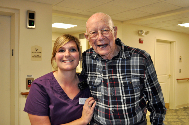 Kacie Gallant and a Lincoln Home resident share smiles during the day.