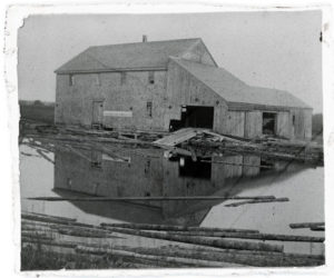 An 1896 photo of the Mill at Pemaquid Falls shows a nine-over-six window next to the ramp which was used to pull logs through the open door. (Photo courtesy Chuck Rand)