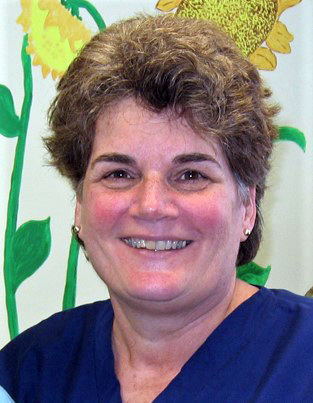Karen Howell, registered nurse, in the earlier days when she managed the operating room.