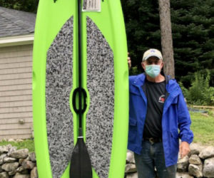 Rotary Vice President Bill Vaughan and the Lifetime Freestyle XL 9'8' paddleboard and paddle being raffled