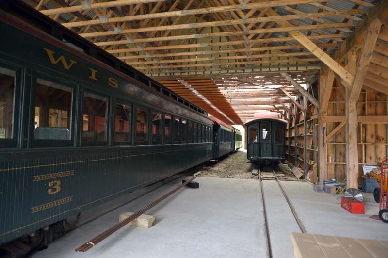 Coach car No. 3, an original car to the Wiscasset, Waterville & Farmington Railroad, sits inside the new section of the car barn at the Wiscasset, Waterville & Farmington Railway Museum in Alna. The Maine Narrow Gauge Railroad Co. & Museum owns the car, which is scheduled to be repaired at the Alna facility. (Paula Roberts photo)