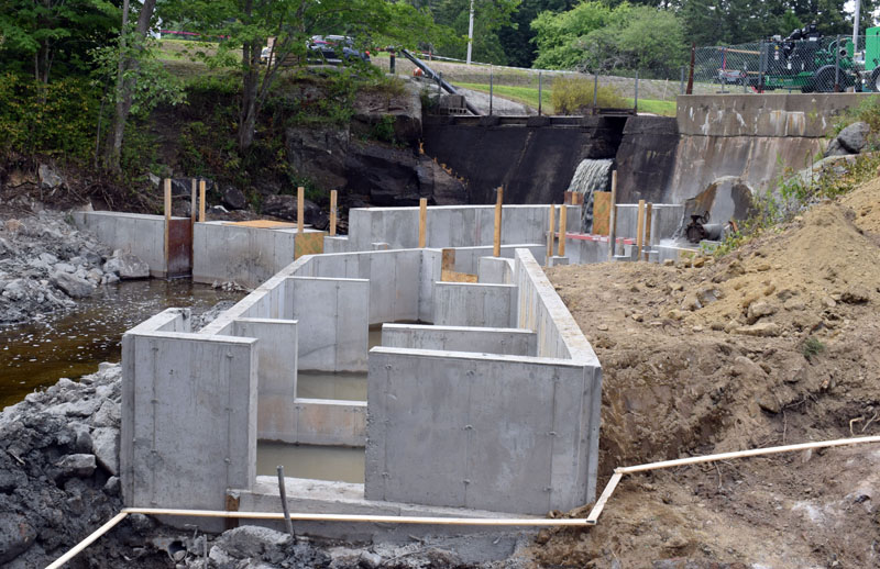 A view of the progress on the new fish ladder below the Bristol Mills Dam on Monday, Aug. 10. Mark Becker, of Nobleboro's Becker Construction Inc., said 14 more concrete pools have to be installed and stonework has to be done to complete the ladder by the beginning of winter. (Evan Houk photo)