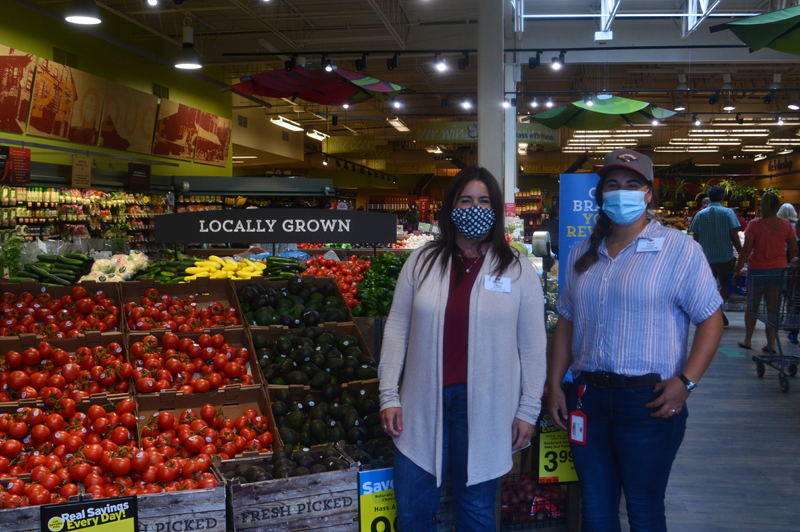 Store Manager Melissa Zayac and Retail Management Trainee Maria Nappi pose in the store's produce section. Along with the store's other leaders, Nappi and Zayac have guided the staff through uncertain times this spring. (Alyce McFadden photo)