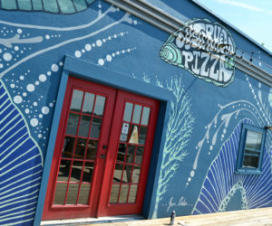Artist Jenny Arter recently completed an abstract mural at Oysterhead Pizza Co. in downtown Damariscotta. (Maia Zewert photo)