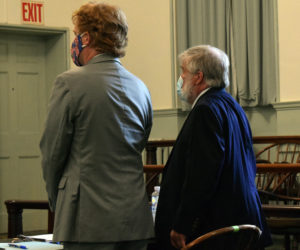 Defense attorney James Mason (left) stands with his client, disbarred attorney Jonathan Hull, of Newcastle, during Hull's sentencing for his embezzlement of funds from two nonprofits, at the Lincoln County Courthouse in Wiscasset on Tuesday, Aug. 25. (Evan Houk photo)