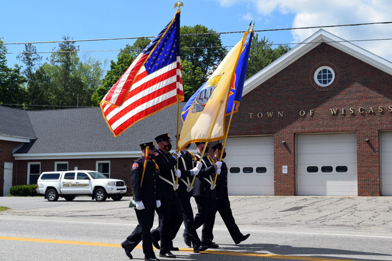 A color guard from the Hackensack Fire Department, of New Jersey, marches in a procession to honor firefighter Richard Kubler on Route 1 in Wiscasset, Saturday, Aug. 1. (Hailey Bryant photo)