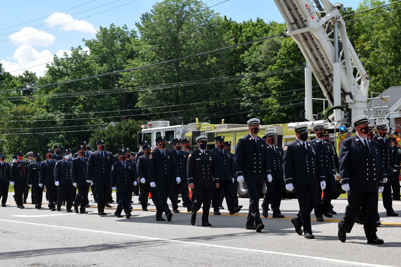 Members of the Hackensack Fire Department, of New Jersey, march in honor of firefighter Richard Kubler on Route 1 in Wiscasset, Saturday, Aug. 1. (Hailey Bryant photo)