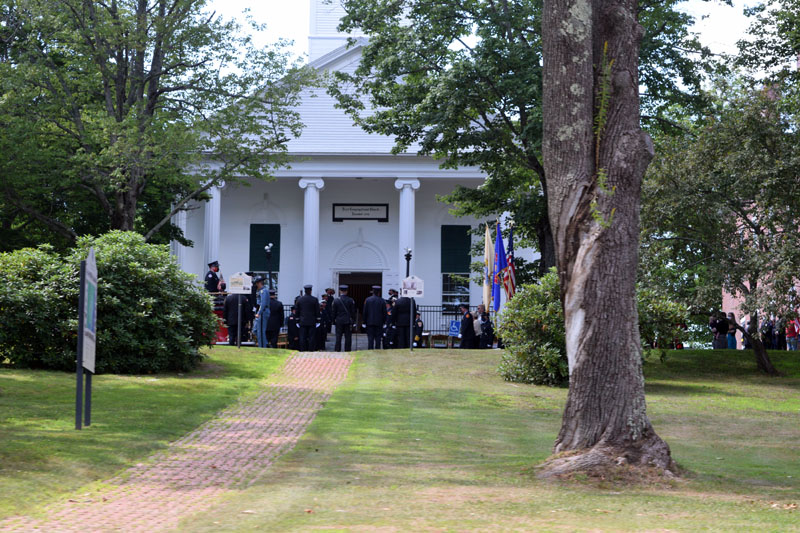Family and friends of Richard Kubler, including many fellow firefighters, gather outside the First Congregational Church of Wiscasset, Saturday, Aug. 1. (Hailey Bryant photo)