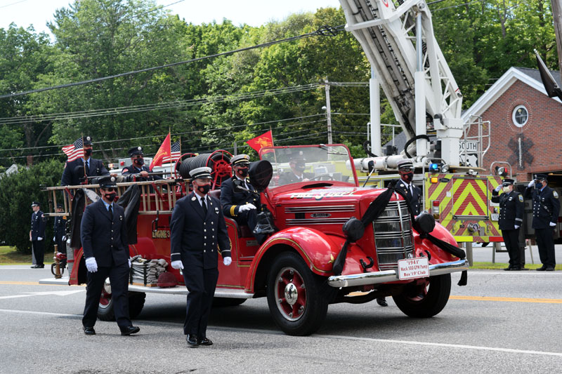 Black bunting covers the lights of an antique fire truck during a procession in honor of firefighter Richard Kubler on Route 1 in Wiscasset, Saturday, Aug. 1. (Hailey Bryant photo)