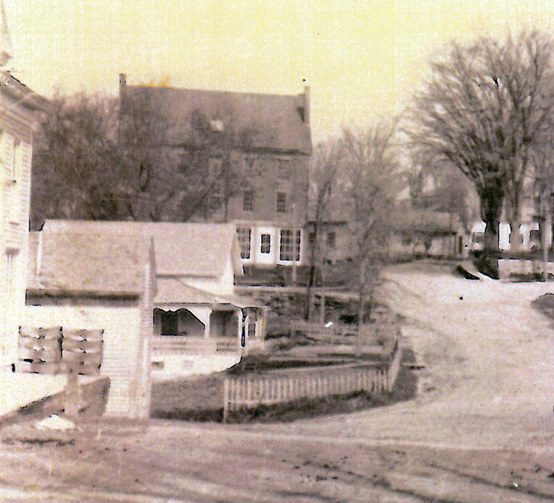 The Dray house with its porch and wooden fence. When the state widened the road and built a new bridge in 1952, the house was moved to Mills Road. (Photo courtesy Newcastle Historical Society Museum)