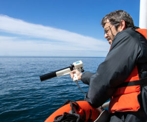 Senior research scientist Barney Balch collects ocean optics data during a research cruise in the Gulf of Maine. Balch is part of a team that has established a new approach to detect algae and measure key ocean properties using light. (Photo courtesy Bigelow Laboratory for Ocean Sciences)