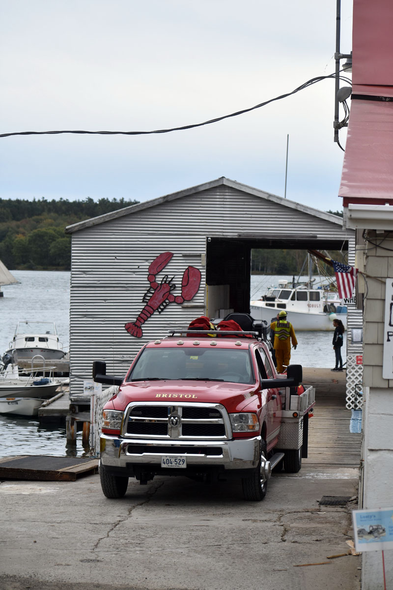 A Bristol fire truck at Broad Cove Marine Services in Bremen on Tuesday, Sept. 22. Firefighters from Bremen, Bristol, Damariscotta, and the Maine Forest Service crossed Hockomock Channel to fight a brush fire on Bremen Long Island. (Alexander Violo photo)