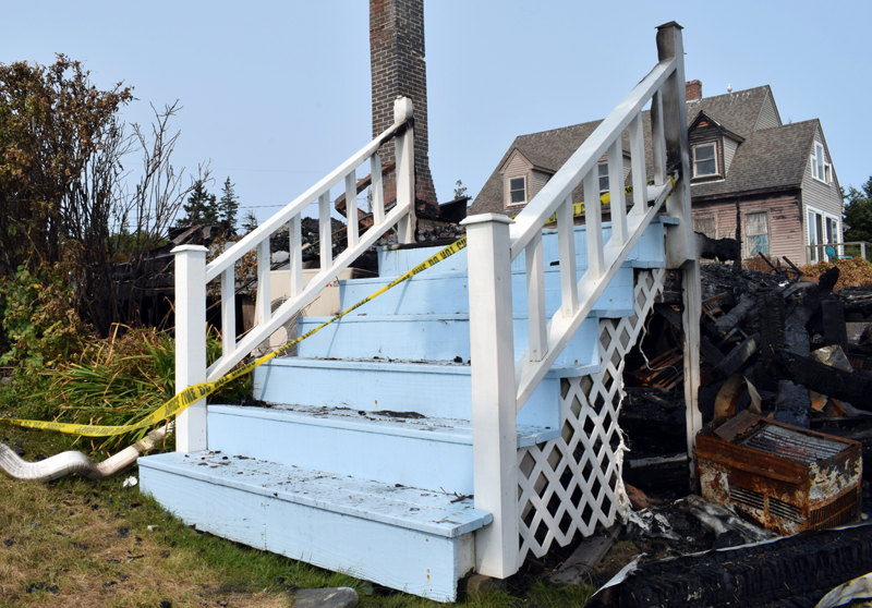 The staircase to the dining room of the Seagull Shop was one of the only things to survive the fire Wednesday, Sept. 9. Co-owner Tim Norland said the staircase was a favorite spot for parents to take pictures of their children throughout the years and he plans to incorporate it into the new building. (Evan Houk photo)